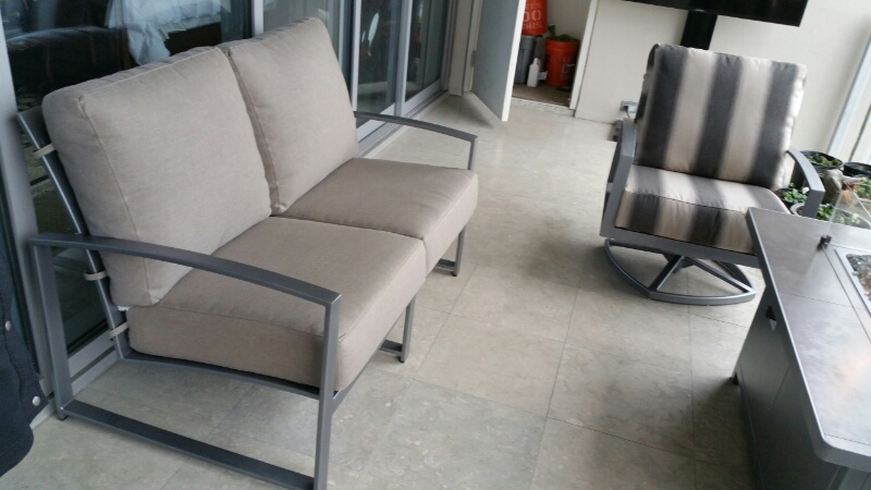 Pacifica Loveseat and Swivel Club Chair on a Balcony