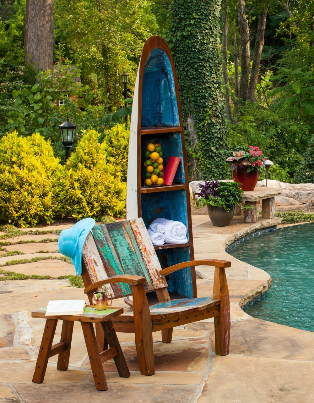 The Max Chair is comfortable and heavy enough not to blow around in bad weather. It doesn't have a problem with wet bathing suits either. The Boat Rack has plenty of storage room for towels and sunscreen or anything else you need to relax by the pool.
