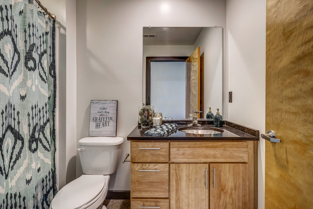 Deluxe Bathrooms - Bathrooms feature bathtubs, hardwood cabinetry and granite counter tops.