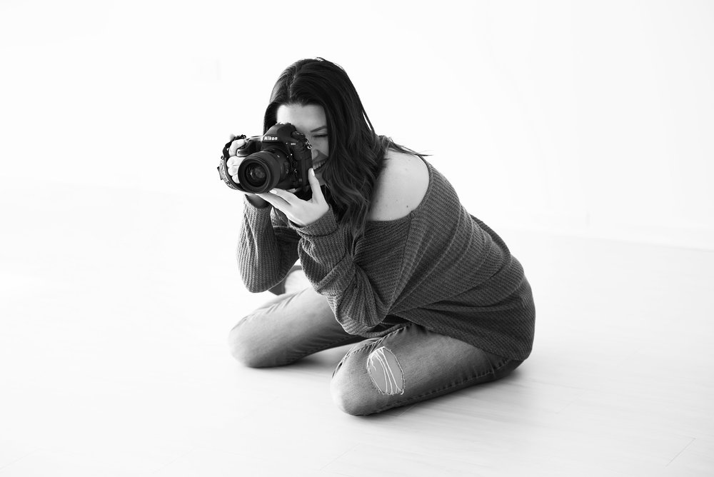 I'm Ania. - I'm an Illinois based photographer who specializes in capturing real moments, genuine connections, and true love.Outside of work, you'll usually find me barefoot on a beach, or exploring new places with my husband and two boys, or enjoying a cocktail with friends.