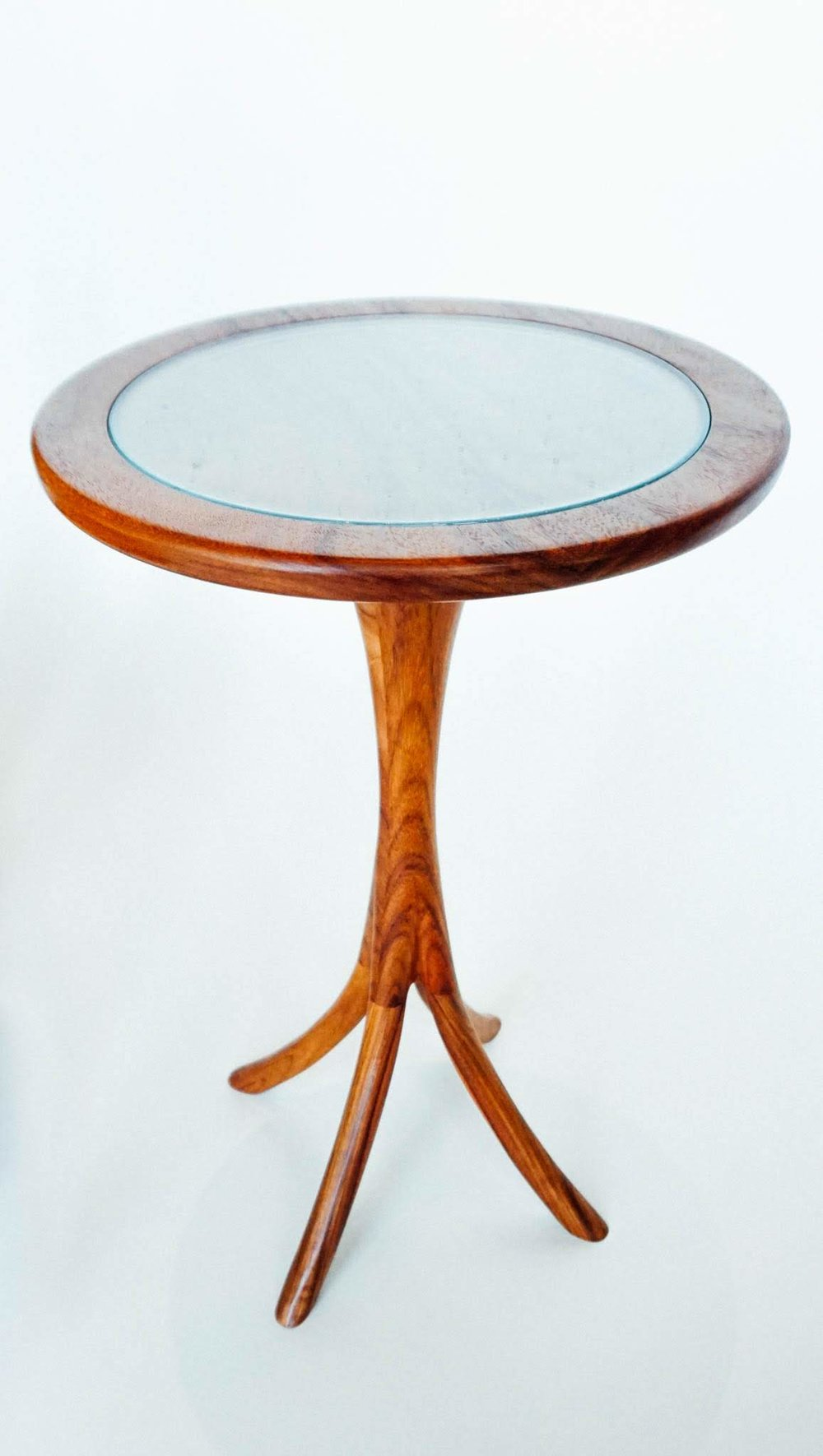 "The table is approximately 22"" tall and 14"" in diameter and shown in macawood. It is perfect for a cuppa of whatever suits you. The custom made glass top provides visibility to the wood's beauty and an attractive cover to prevent damage to the finish. It is the perfect complement to your new chair."