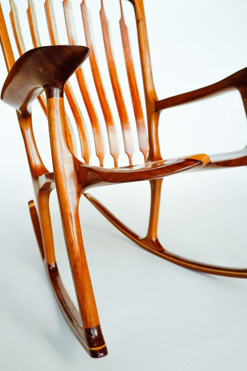 The thin profile of the seat and arms provides a more contemporary look to a traditional piece.