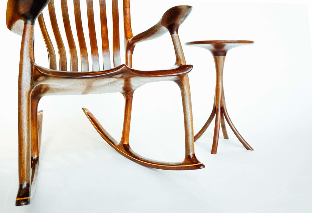 The seat of the chair is sculpted for maximum beauty and comfort.