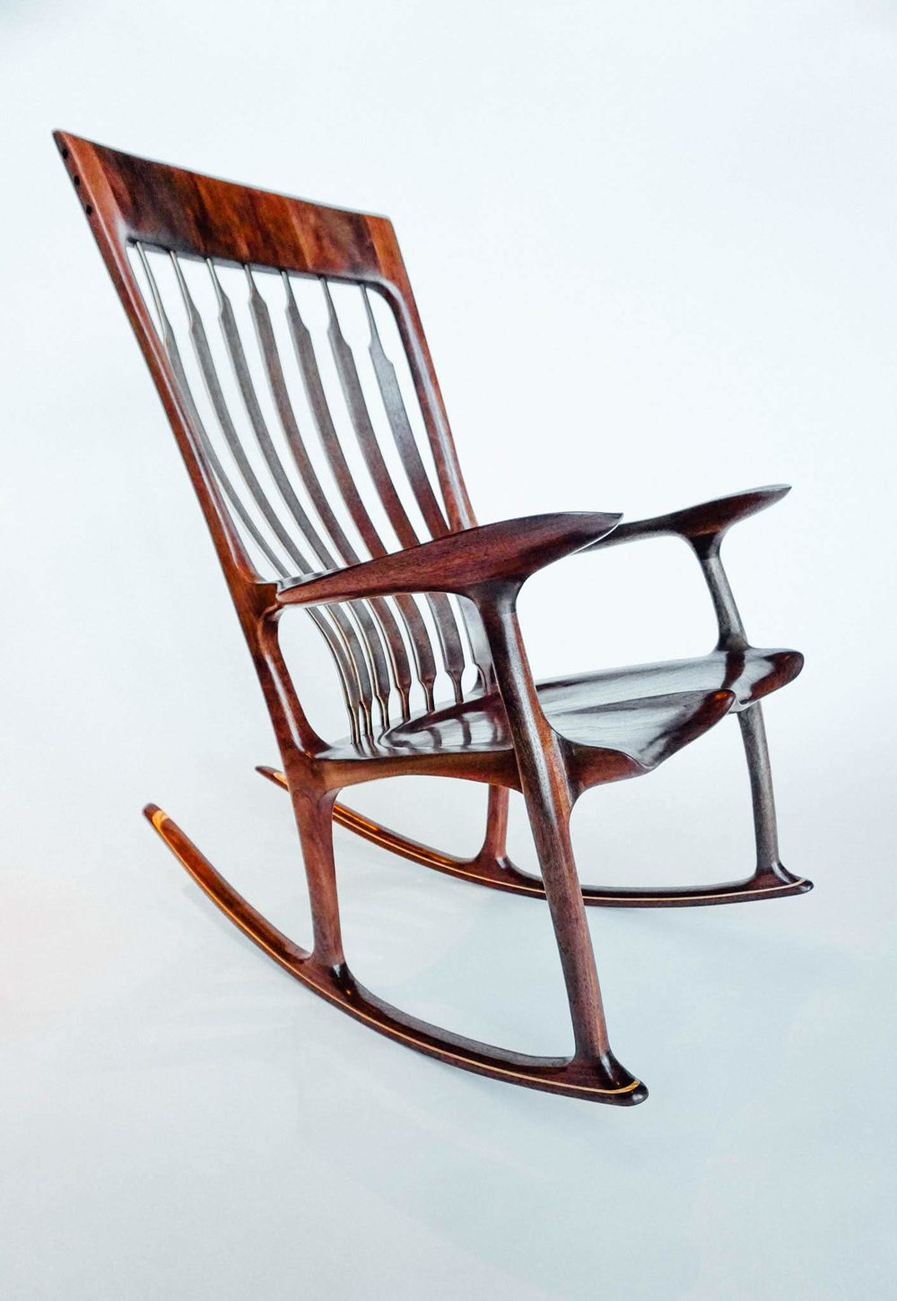 This profile shot provides a nice look at the subtle curves in the seat to leg transitions.  Also note the maple wood highlight in the rocker.  This is a popular but optional feature.