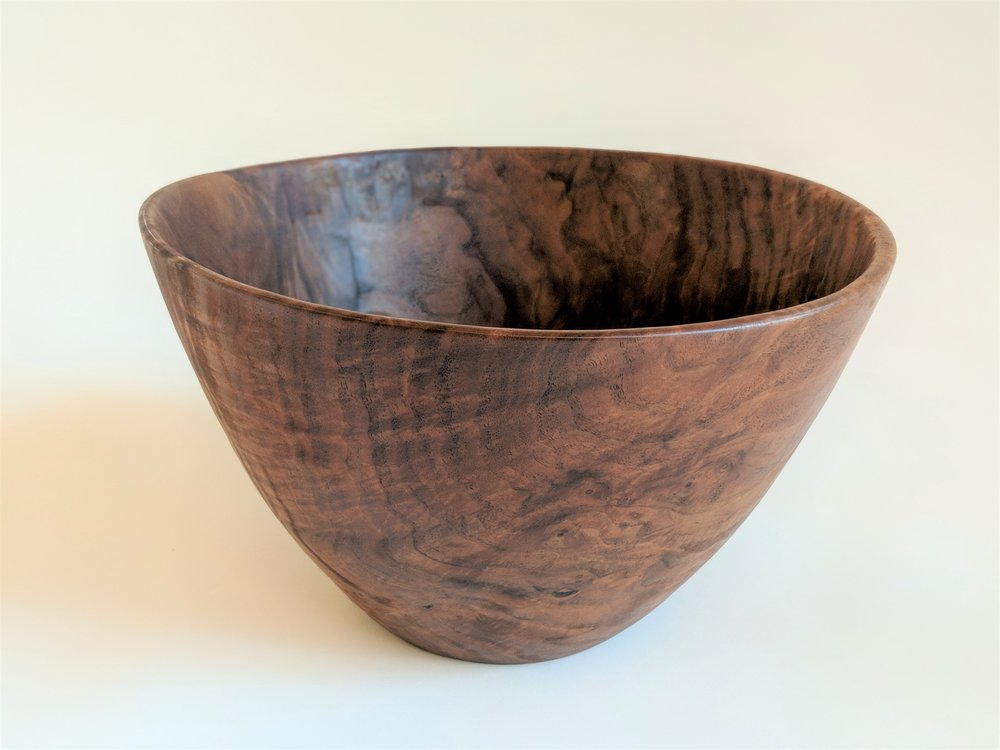 "I have made a lot of salad bowls over the years. I try to find interesting wood to make the bowl beautiful. My standard salad bowl is about 13"" in diameter and 8"" deep. While this seems to be the favorite size they can be made to your specification.  This bowl is made from figured claro walnut.   Photo: Pf Woodworking"