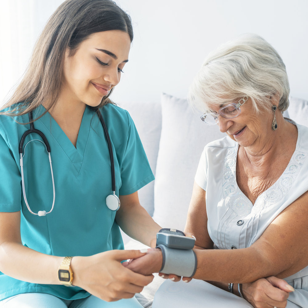 nurse-taking-blood-pressure.jpg