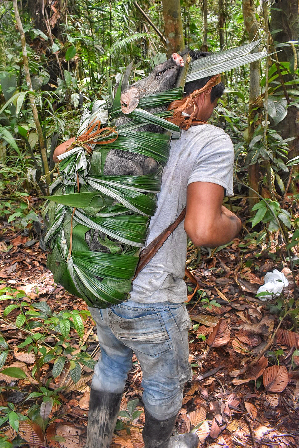 Fransisco, with the boar in his hand crafted backpack. Image by Scott Haber