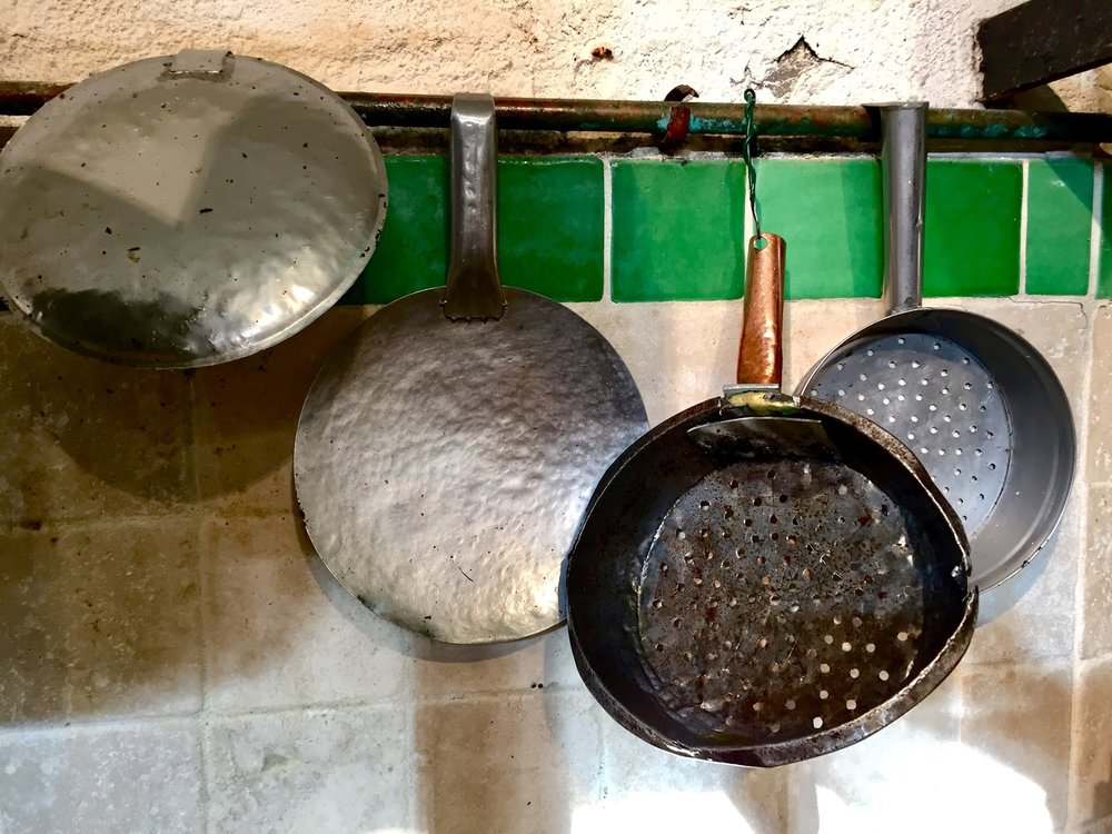 The battered old scoops used to get the olive oil and pulp out of the grinding basins.