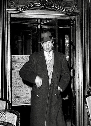 Gary Cooper leaving a Paris restaurant in the 1920's