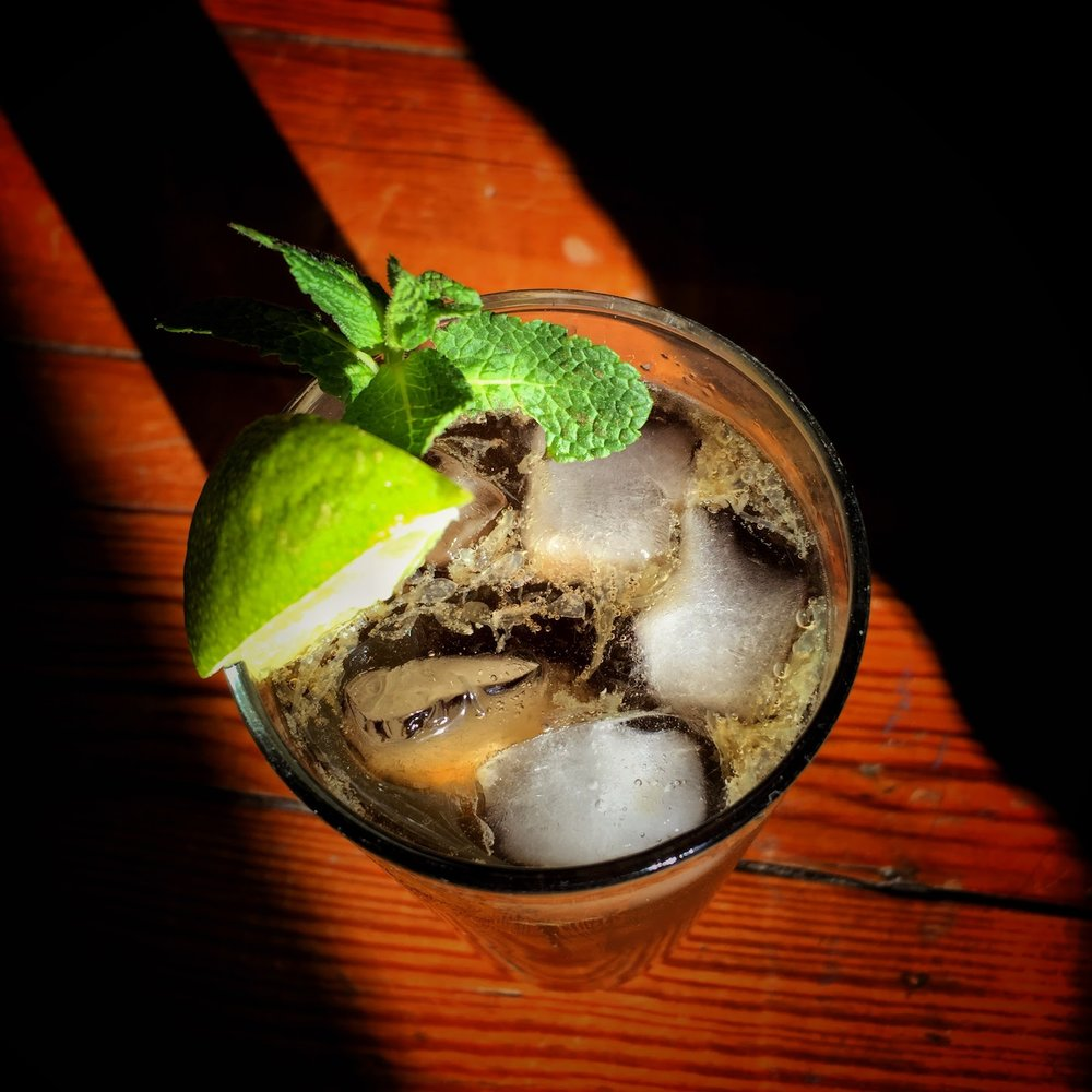 A Cuba Libre with muddled fresh lime