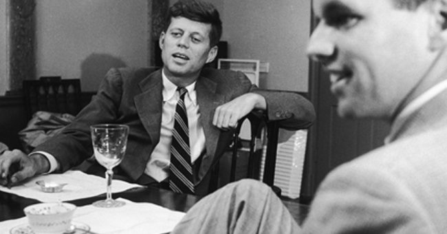 President John F. Kennedy with his brother Bobby (R)