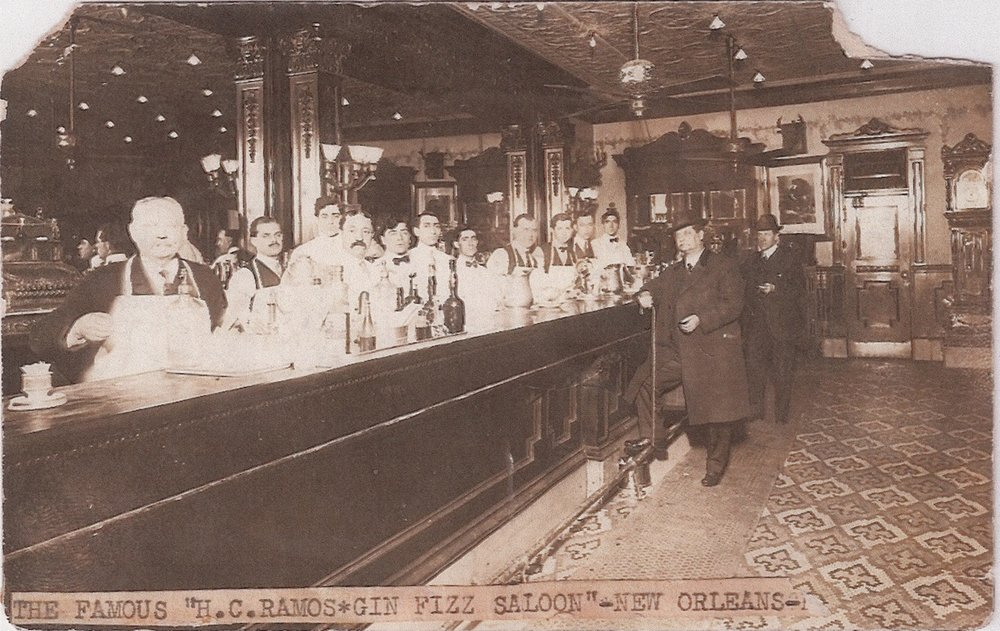 """""""The famous H.C.Ramos Gin Fizz Saloon - New Orleans"""" - lots of barmen but, on this occasion, few customers!"""