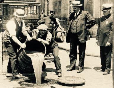 Prohibition: Police pouring illicit liquor down the drain.