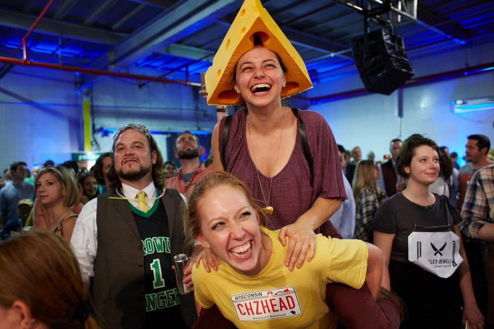 Rachael Faulds and Jen Roit cheer on competitors in the final cheese-themed contest pairing cheese and beer.  STEVE REMICH FOR THE WALL STREET JOURNAL