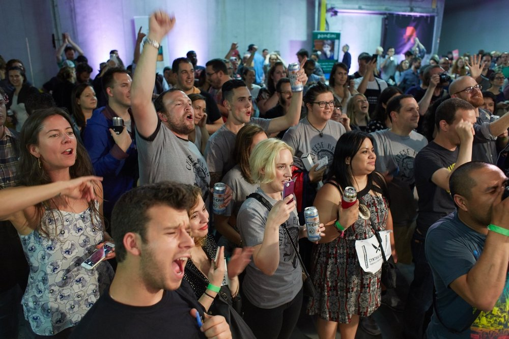 The crowd cheers on competitors in a contest pairing cheese and beer.  STEVE REMICH FOR THE WALL STREET JOURNAL
