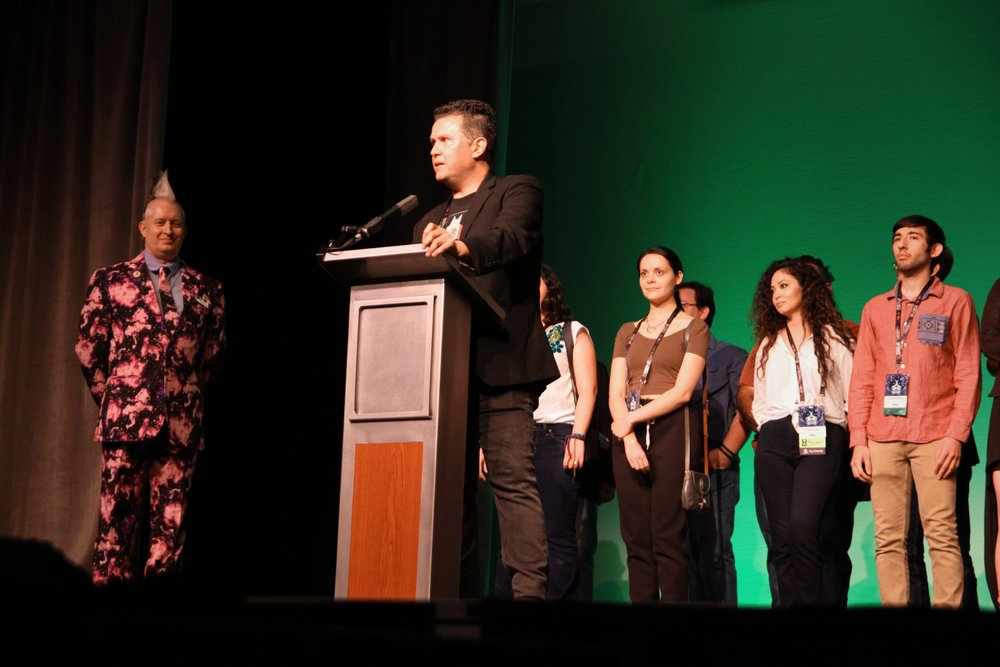 John Picacio speaking at the opening ceremonies of WorldCon 76