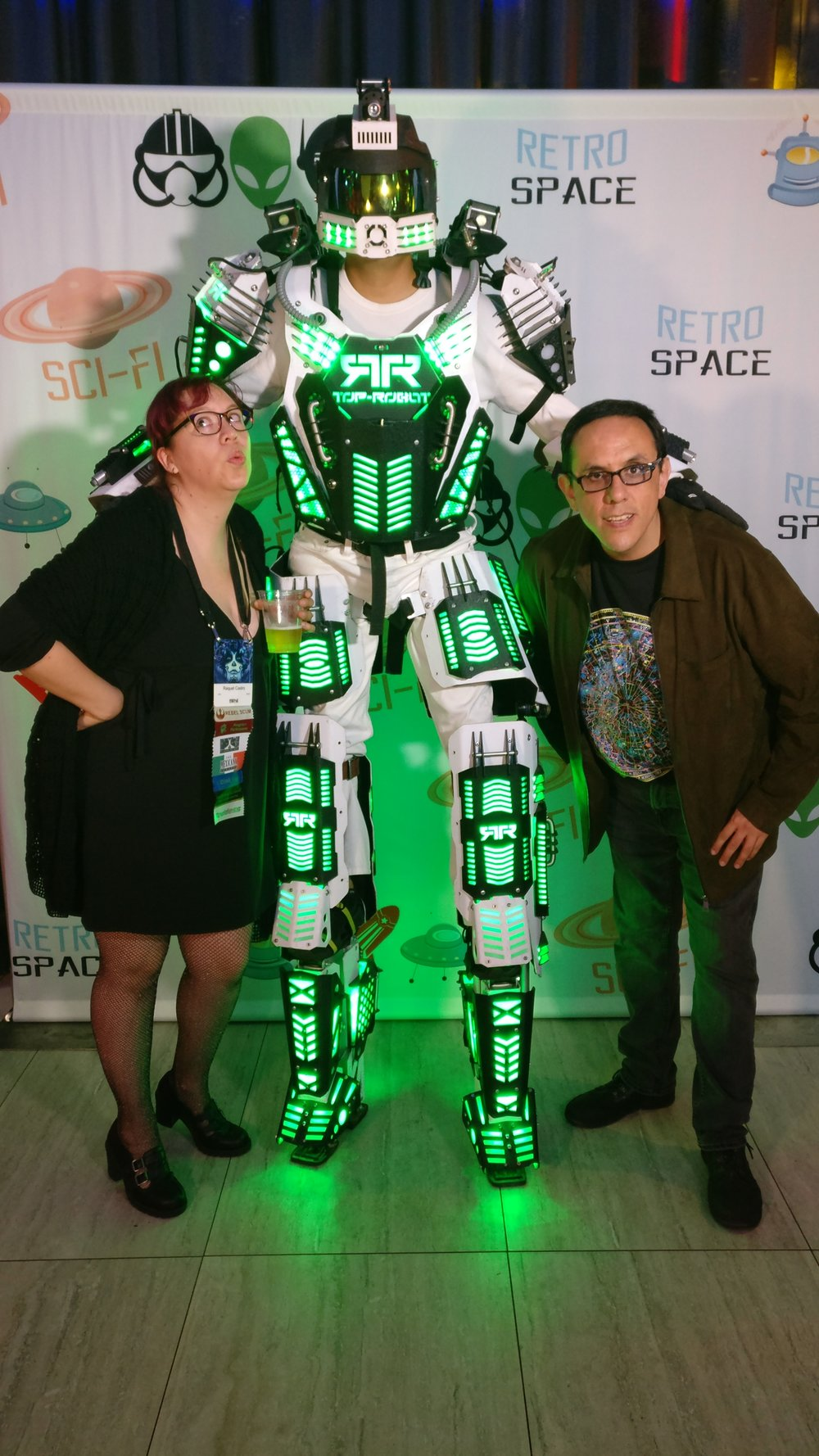 Raquel Castro and Alberto Chimal with a giant robot at the Hugo Losers Party