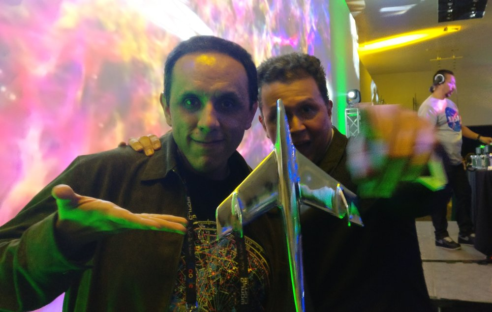 Alberto Chimal and John Picacio pose with John's Alfie Award