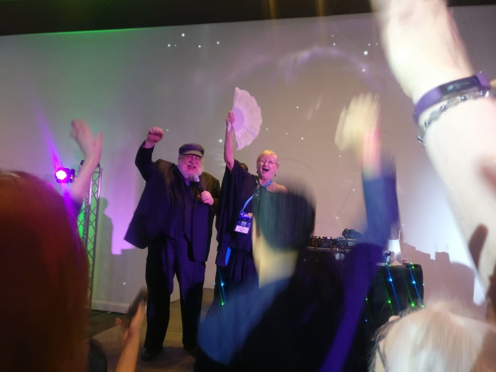 George R. R. Martin leading the crowd in a cheer at the Hugo Losers Party