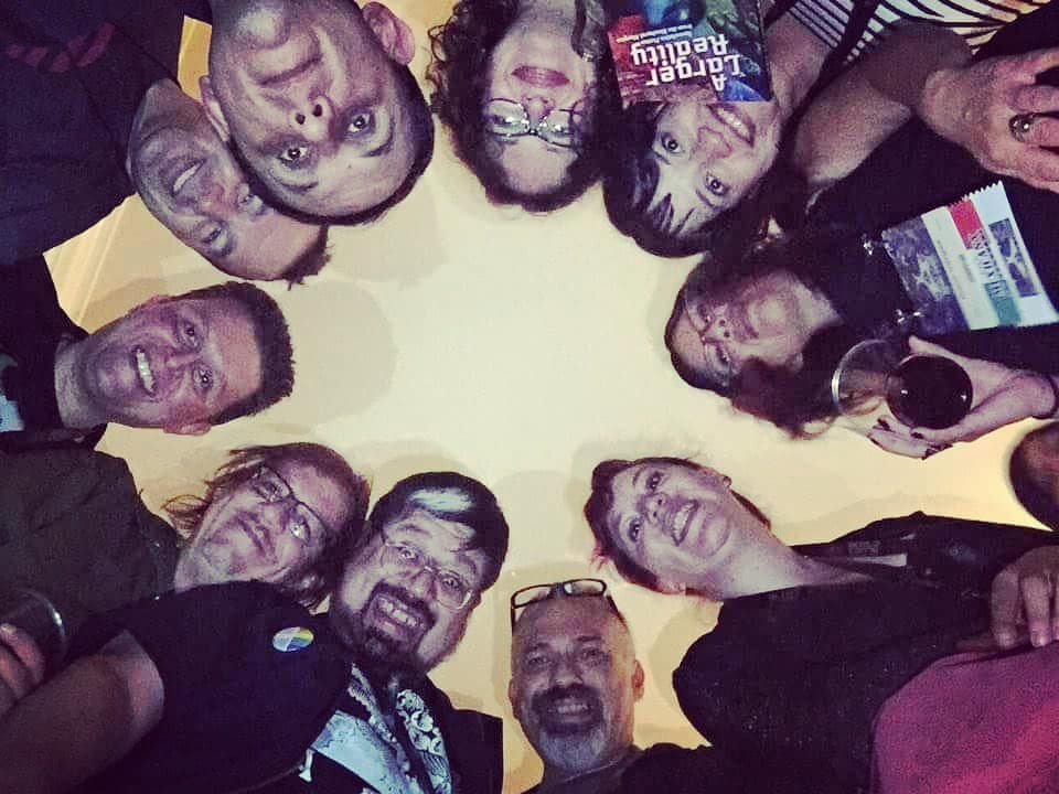 A selfie from below of a circle of Mexicanx Initiative participants huddled together at the Mexicanx Initiative Reception (Photo by Alberto Chimal)