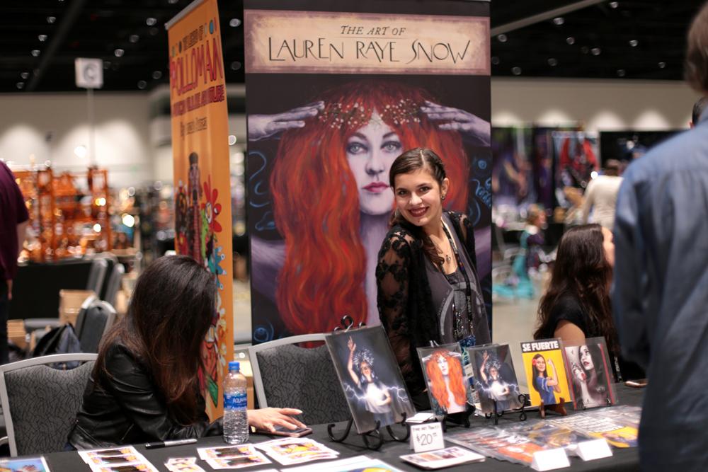 Lauren Raye Snow with a display of her art (Photo by Dianita Cerón)