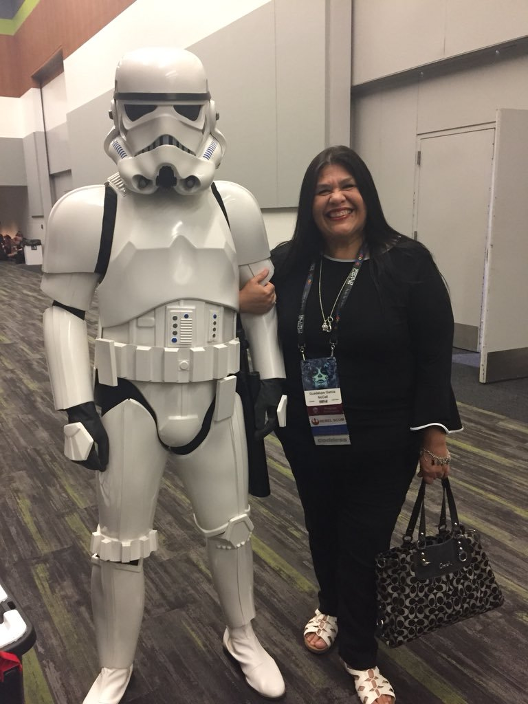 Guadalupe Garcia McCall with a stormtrooper at Worldcon 76 (Sent by Guadalupe Garcia McCall; photo by Anonymous on Guadalupe's phone)