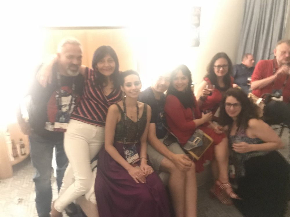 Blurry partiers: Gerardo Horacio Porcayo, Patty Garcia, Kirtana Rex, Héctor Gonzalez, Gabriela Damián, Libia Brinda, and Adrea Chapela at the Locus party on Saturday night at Worldcon 76 (Photo by Julia Rios)
