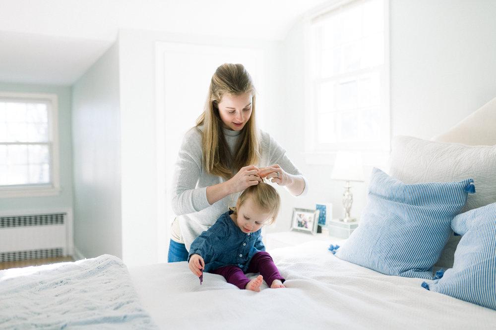 westport family photographer_fairfield county lifestyle photographer_CT lifestyle photographer_mother doing daughter's hair
