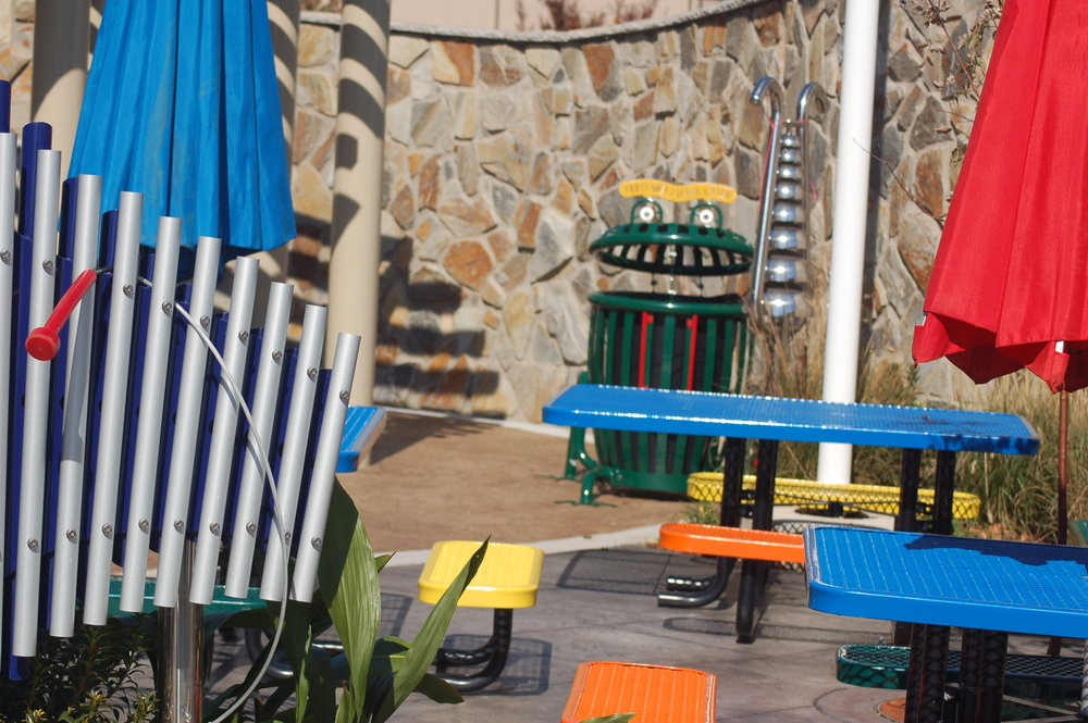 06 - outdoor chimes with bells and picnic tables in the background.JPG