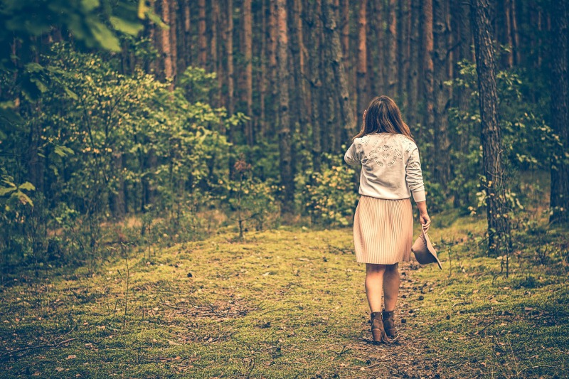 woman walking forest small.jpg