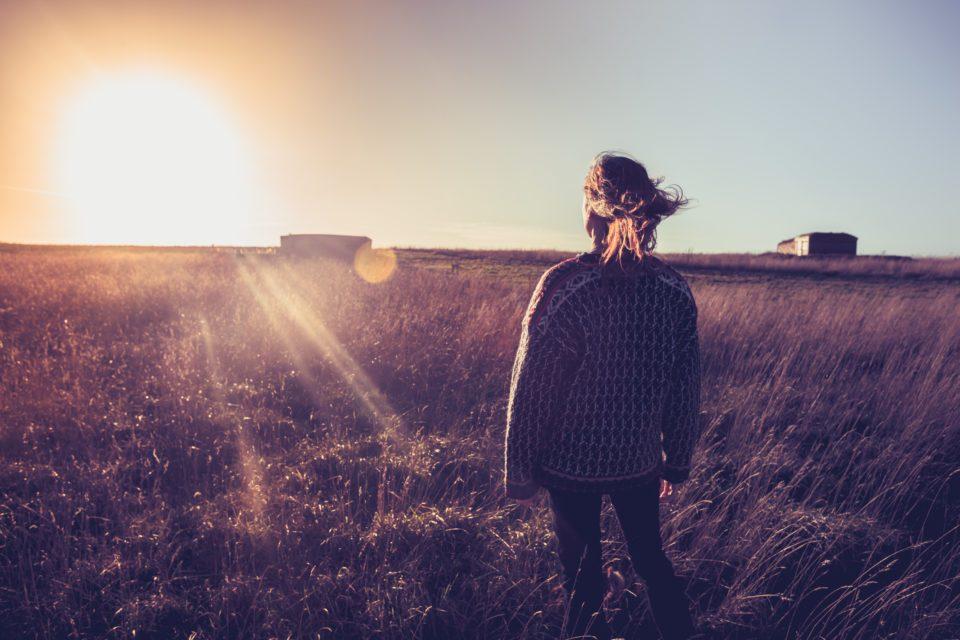 Woman-standing-in-field-960x640.jpg
