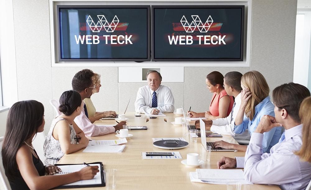 group-of-businesspeople-meeting-around-boardroom-PLTNCLQ.jpg