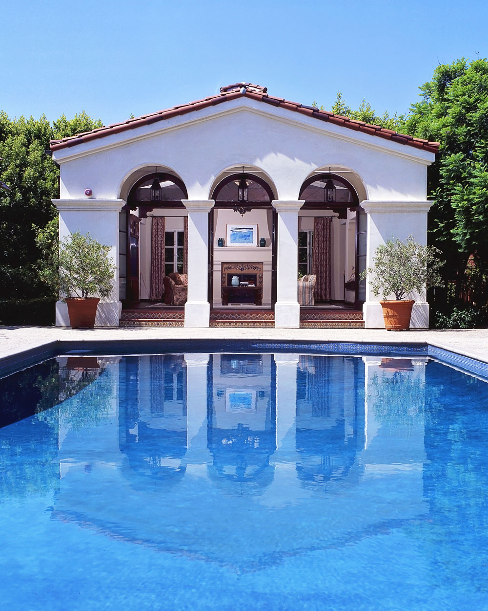 10-pool-poolhouse-exterior-spanish-dee-carawan.jpg