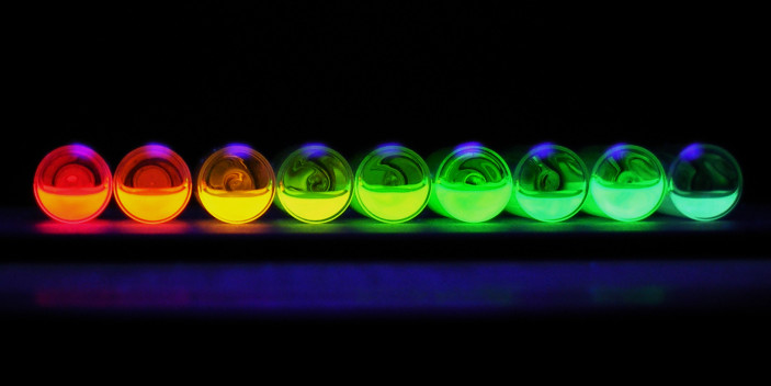 "Colorful Quantum Dots in solution. Image credit:  Flickr user ""clancefield""     (CC BY-NC-ND 2.0)"