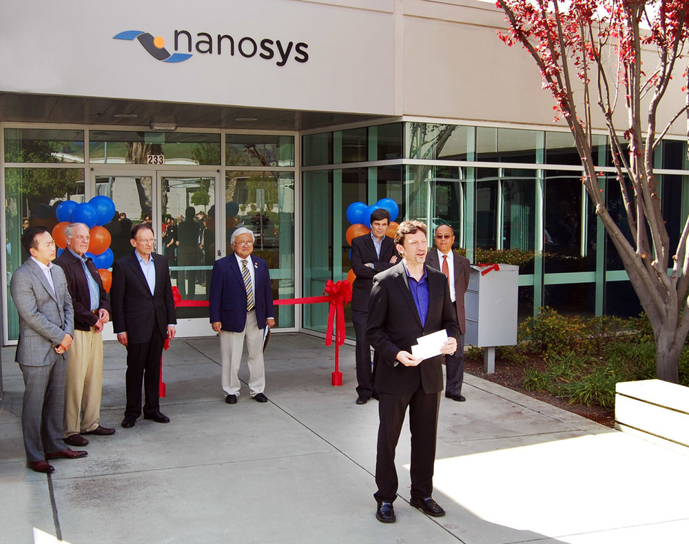 Nanosys Milpitas Ribbon Cutting Ceremony; pictured from left to right are Nanosys Board Members Nelson Chan, John Young and Steve Goldby; Representative Mike Honda, Erik Jostes, Nanosys CEO Jason Hartlove and Milpitas Mayor Jose Esteves