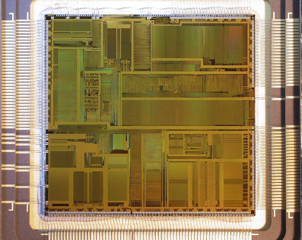 """Caption: UHD OLED TVs remain difficult to make with nearly 40 million transistors or more than 8 times the number found in the original Intel Pentium chip pictured here. Photo Credit: """"Intel Pentium A80501 66 SX950"""" by Pdesousa359 - Own work. Licensed under Creative Commons Attribution-Share Alike 3.0 via Wikimedia Commons -    http://commons.wikimedia.org/wiki/File:Intel_Pentium_A80501_66_SX950.JPG#mediaviewer/File:Intel_Pentium_A80501_66_SX950.JPG"""