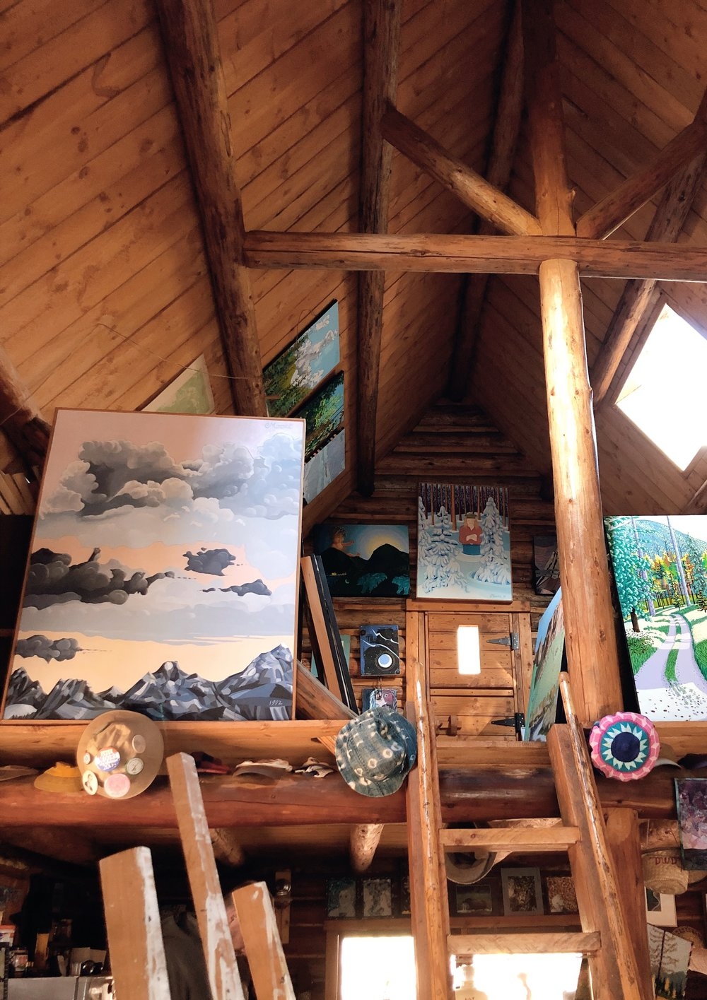 View to the loft. Paintings everywhere.