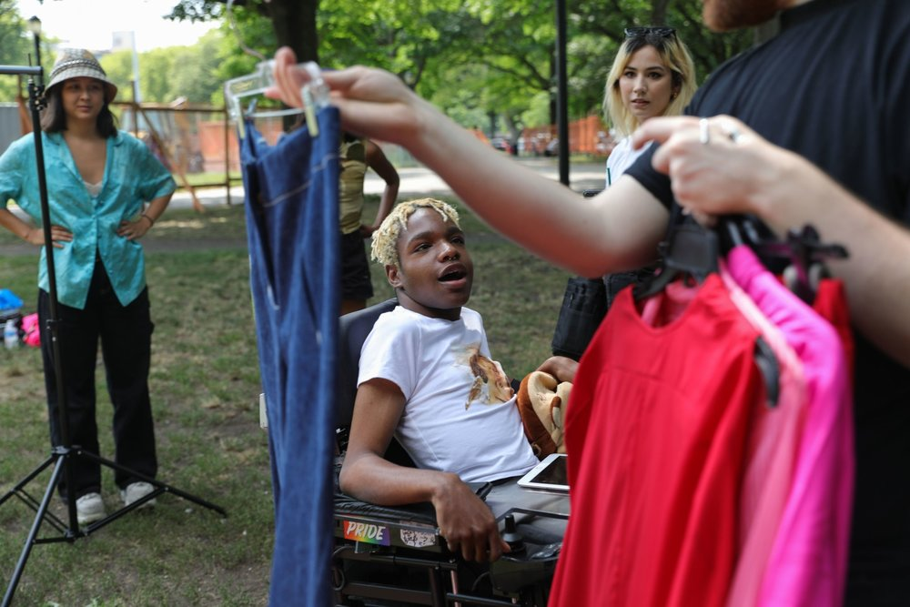 Aaron Philip getting ready for a photo shoot at McCarren Park in Brooklyn. Credit: Gabriella Angotti-Jones/The New York Times