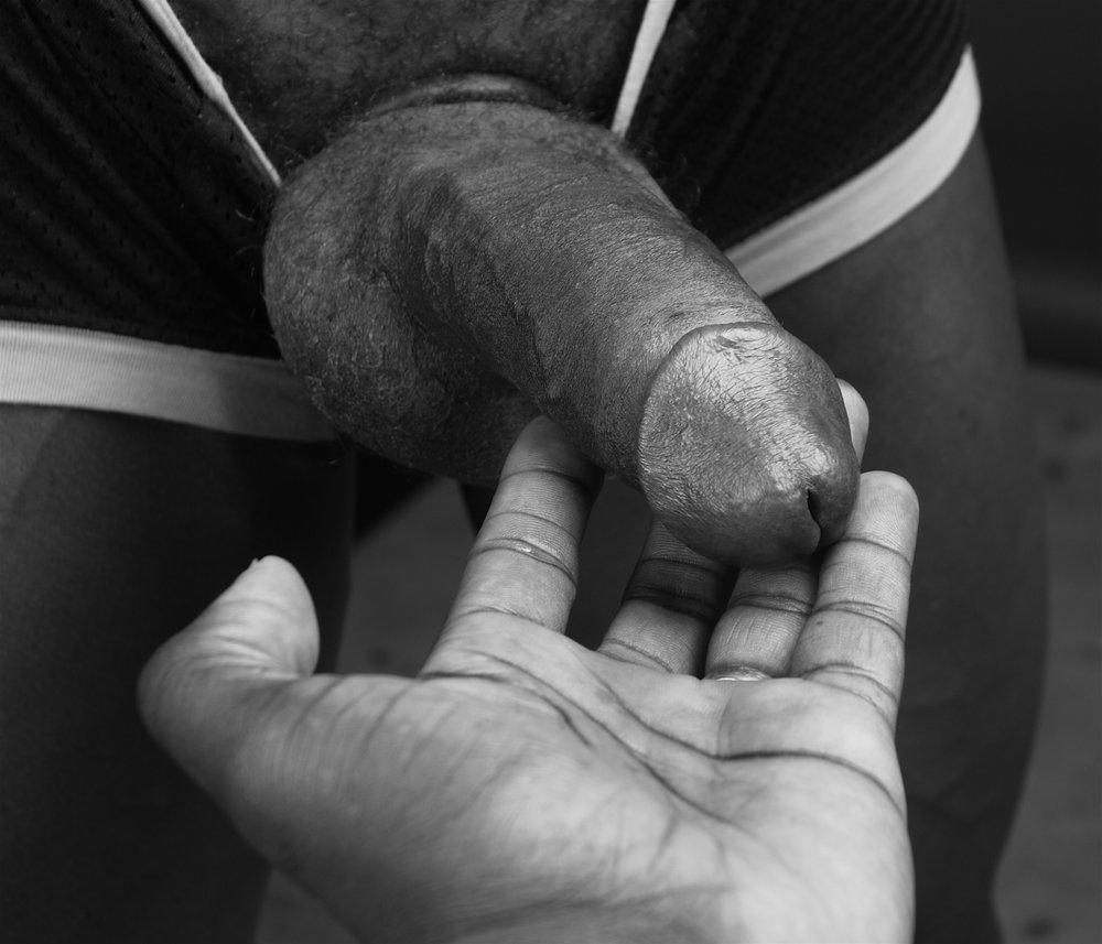 Ajamu's hand holding dick image 4 2015.JPG