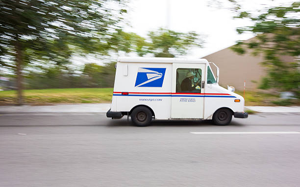 Miami, USA - January 18, 2013: United States Post Office mail truck (USPS) speeding in Miami, Florida - motion blur panning.