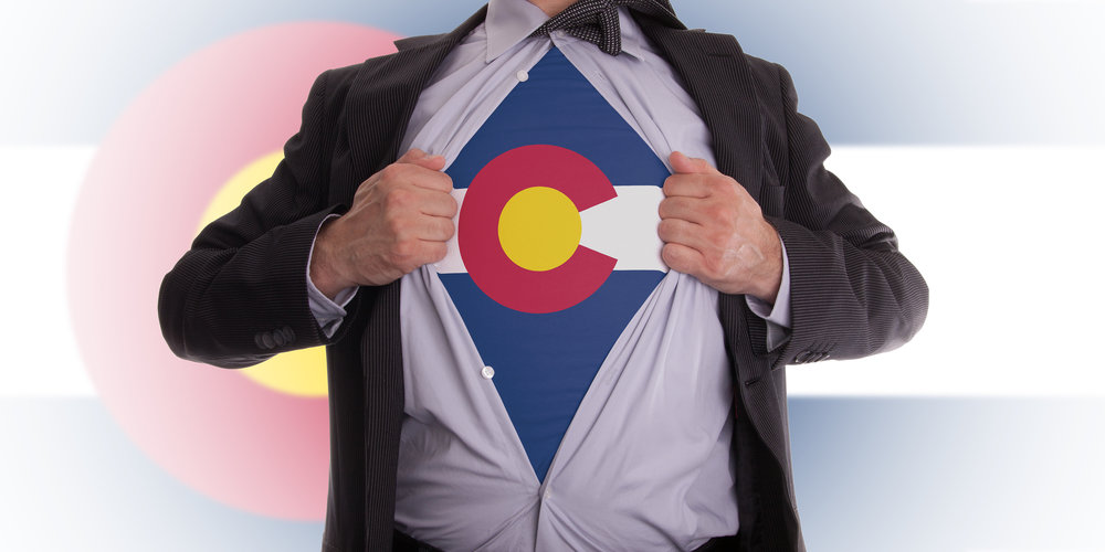 bigstock-Businessman-With-Colorado-Flag-70003552.jpg