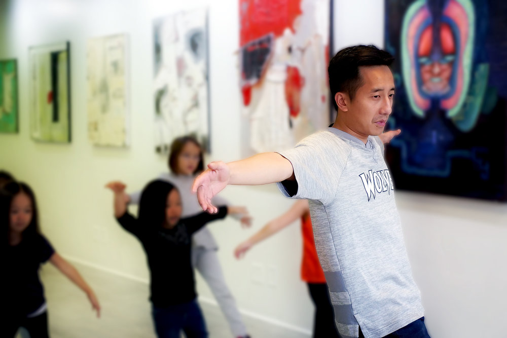 Lue Thao leading a class of young dancers