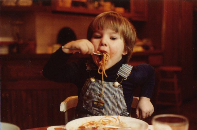 attempting to eat spaghetti