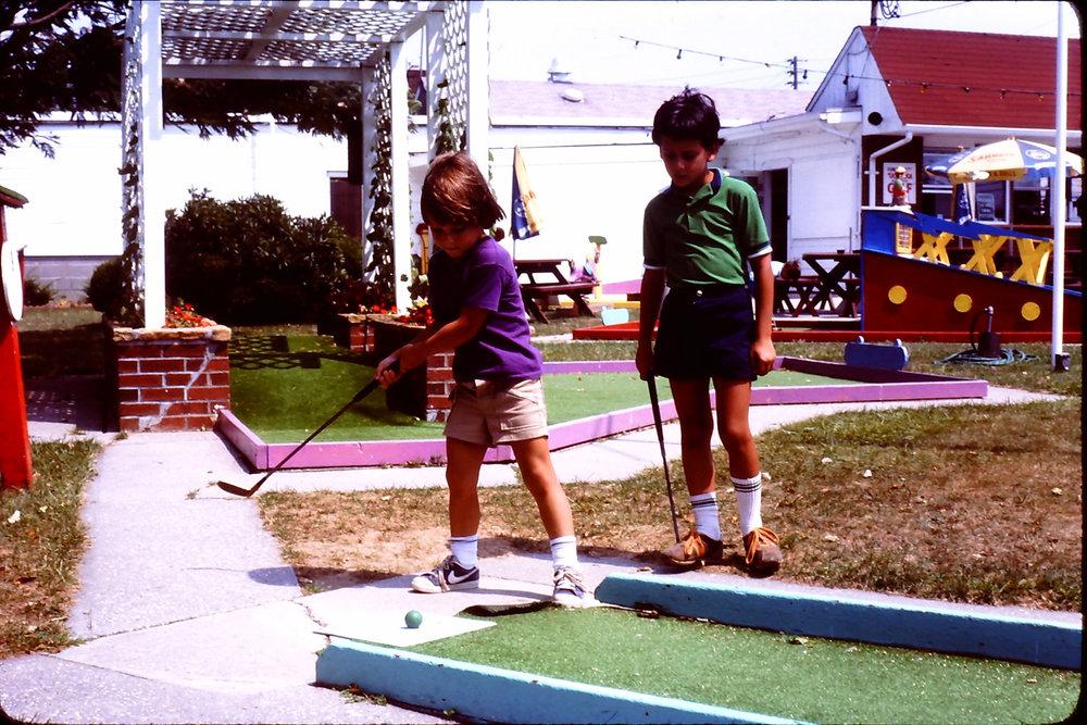 playing mini-golf