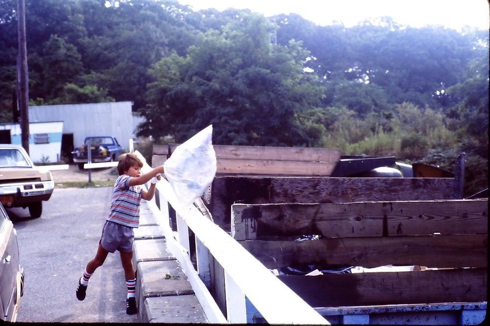 flinging a garbage bag at the dump