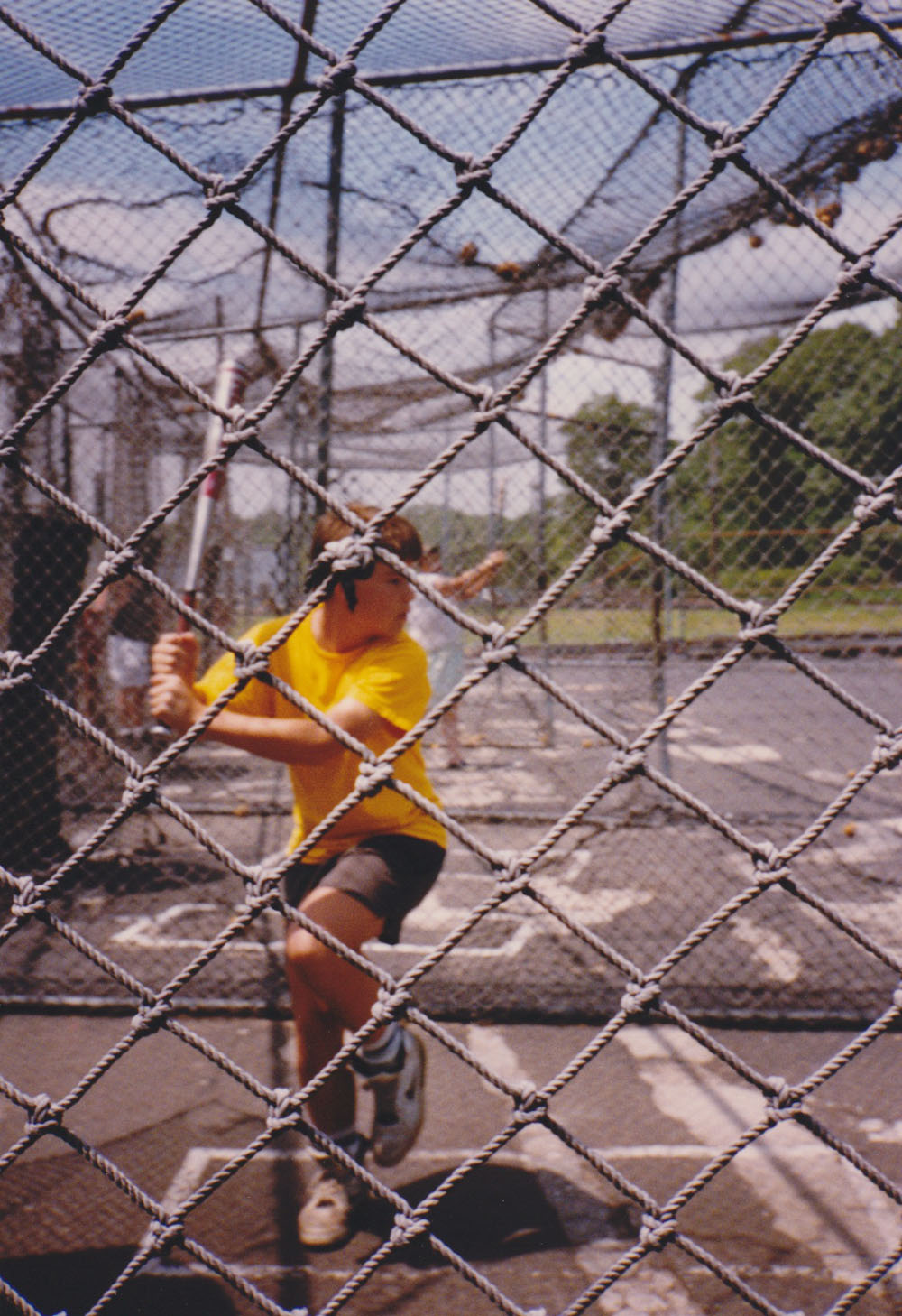 taking some cuts in a batting cage