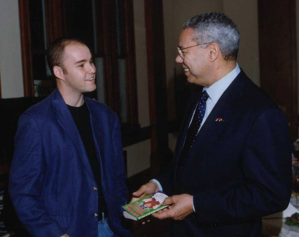 giving a signed copy of my book to Colin Powell
