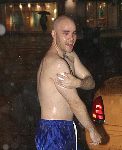 taking a shower on the sidewalk