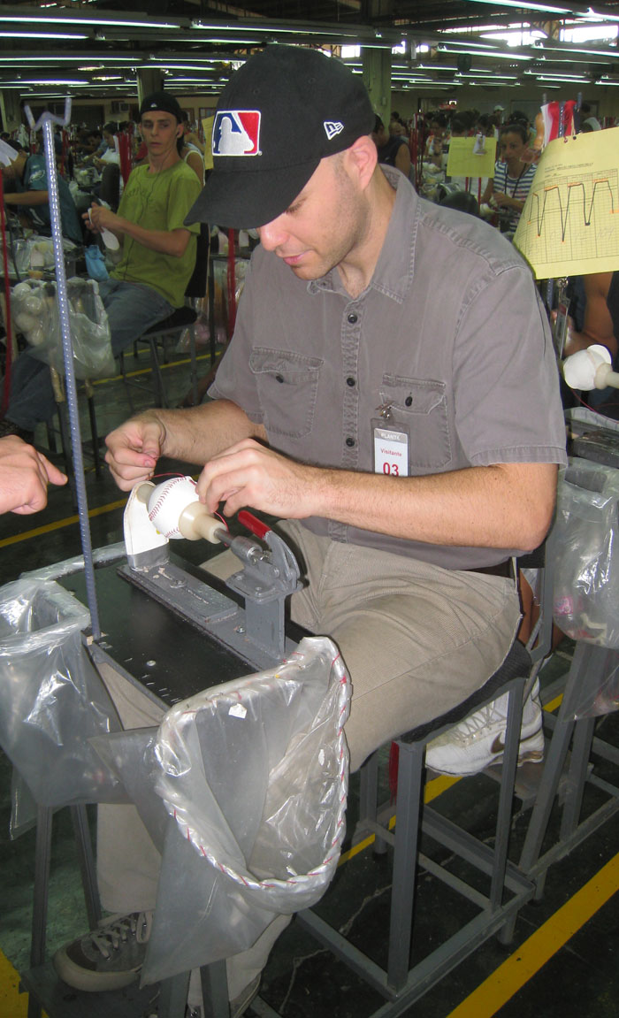 stitching a baseball at the Rawlings factory in Costa Rica
