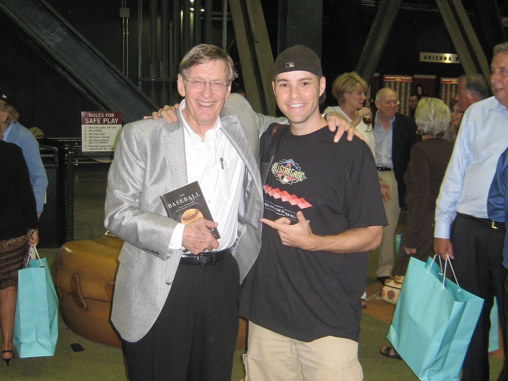 Bud Selig holding my book at an All-Star Game after-party in Arizona